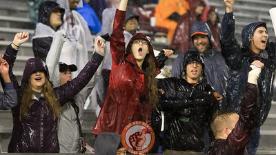 Fans in the South stands dance during a promotion on Hokievision during a TV timeout. (Mark Umansky/TheKeyPlay.com)