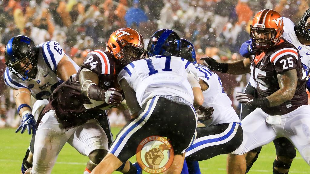 Trevon Hill (94) and Ricky Walker (25) collapse on the Duke pocket in the 4th quarter. (Mark Umansky/TheKeyPlay.com)