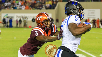 DB Greg Stroman pushes Duke WR Jonathan Lloyd out of bounds. (Mark Umansky/TheKeyPlay.com)