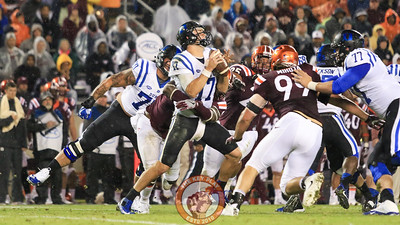 Duke QB Daniel Jones is hit from behind by Trevon Hill for another sack on the day. (Mark Umansky/TheKeyPlay.com)