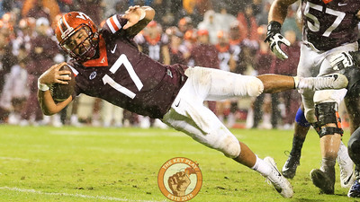 QB Josh Jackson leaps into the endzone on a 4th down run to put the Hokies up 24-3 in the fourth quarter. (Mark Umansky/TheKeyPlay.com)