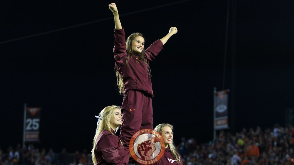 Virginia Tech cheerleaderes perform for the crowd during a break in the action. (Mark Umansky/TheKeyPlay.com)