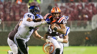 Travon McMillian runs with the football as a pair of Duke defenders attempt to bring him down. (Mark Umansky/TheKeyPlay.com)