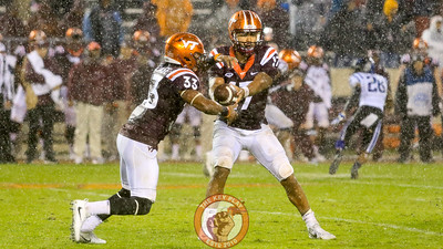 The rain continues to come down hard as Josh Jackson holds out the football for Deshawn McClease in the 4th quarter. (Mark Umansky/TheKeyPlay.com)