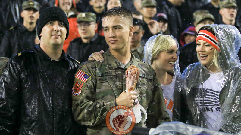 Fans in the South endzone enjoy the rain and a turkey leg as the Hokies start to run out the clock. (Mark Umansky/TheKeyPlay.com)