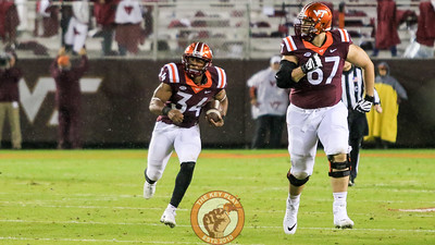 RB Travon McMillian runs in open space as he follows OL Parker Osterloh as a lead blocker. (Mark Umansky/TheKeyPlay.com)