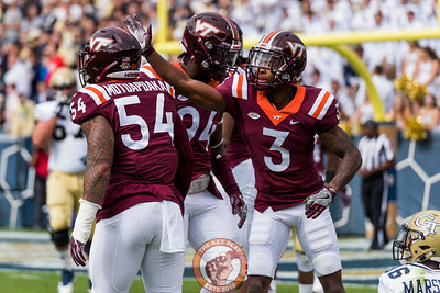 Greg Stroman (3) pats Andrew Motuapuaka (54) on the helmet after a tackle in Saturday's matchup between Virginia Tech and Georgia Tech, Saturday, Nov. 11, 2017. (Special by Cory Hancock)