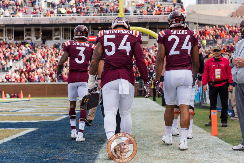 Virginia Tech's Andrew Motuapuaka (54) carries the lunch pail as the captains take the field before Saturday's matchup between Virginia Tech and Georgia Tech, Saturday, Nov. 11, 2017. (Special by Cory Hancock)