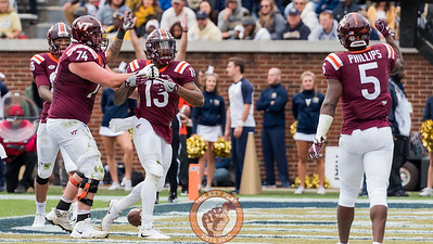 Jalen Holston (13) celebrates a touchdown in Saturday's matchup between Virginia Tech and Georgia Tech, Saturday, Nov. 11, 2017. (Special by Cory Hancock)