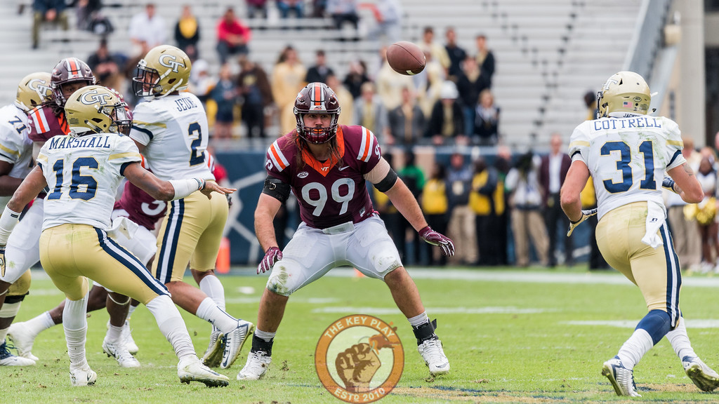 Vinny Mihota (99) watches a pitch from quarterback TaQuon Marshall (16) to Nathan Cottrell (31) during Saturday's matchup between Virginia Tech and Georgia Tech, Saturday, Nov. 11, 2017. (Special by Cory Hancock)