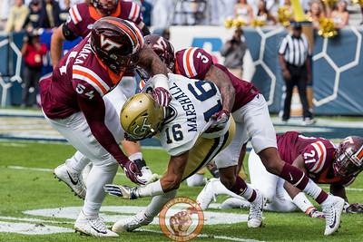 Andrew Motuapuaka (54) and Greg Stroman (3) tackle TaQuon Marshall (16) during Saturday's matchup between Virginia Tech and Georgia Tech, Saturday, Nov. 11, 2017. (Special by Cory Hancock)