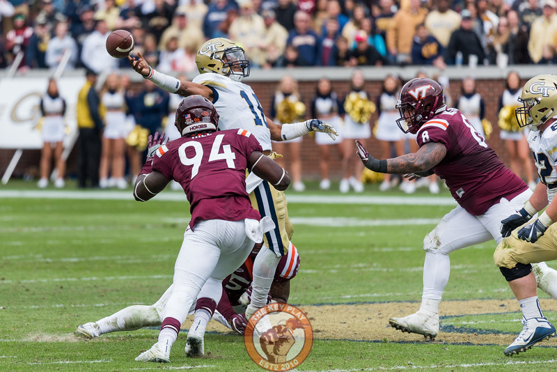 TaQuon Marshall (16) tries to throw as Trevon Hill (94)  Andrew Motuapuaka (behind) tackle him in Saturday's matchup between Virginia Tech and Georgia Tech, Saturday, Nov. 11, 2017. (Special by Cory Hancock)