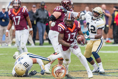 Jalen Holston (13) runs upfield after breaking a tackle in Saturday's matchup between Virginia Tech and Georgia Tech, Saturday, Nov. 11, 2017. (Special by Cory Hancock)