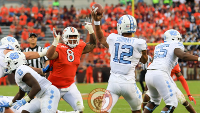 Ricky Walker attempts to bat down a UNC pass while being held from behind. (Mark Umansky/TheKeyPlay.com)