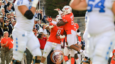 Andrew Motuapuaka (54) jumps onto Ricky Walker (8) after Walker's first career touchdown. (Mark Umansky/TheKeyPlay.com)