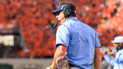 UNC head coach Larry Fedora screams at the referees in a failed attempt to call a timeout. (Mark Umansky/TheKeyPlay.com)