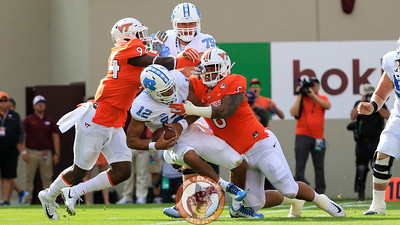 DT Ricky Walker (8) sacks UNC quarterback Chazz Surratt early in the game. (Mark Umansky/TheKeyPlay.com)