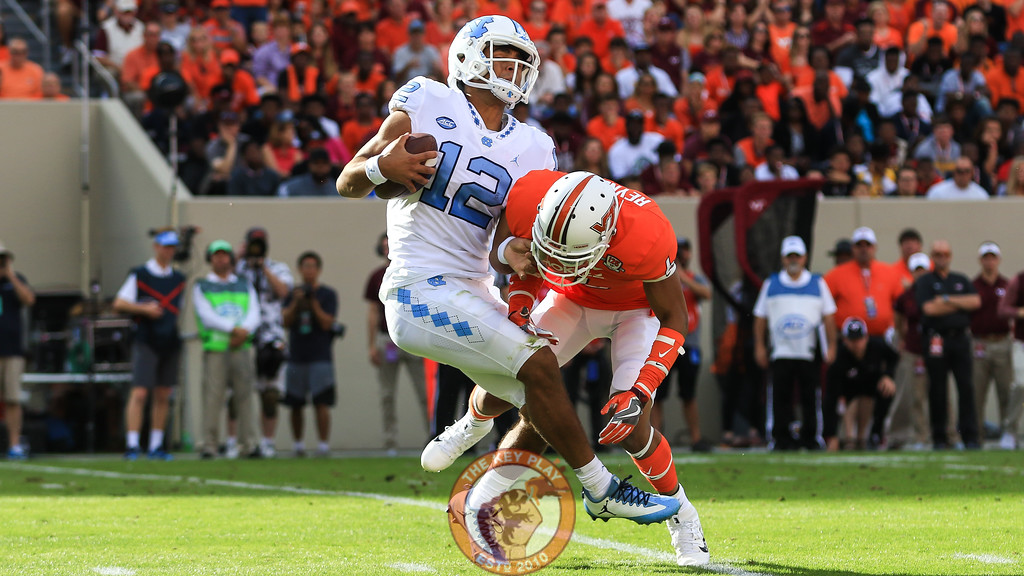 Mook Reynolds attempts to put a hit on UNC QB Chazz Surratt. (Mark Umansky/TheKeyPlay.com)