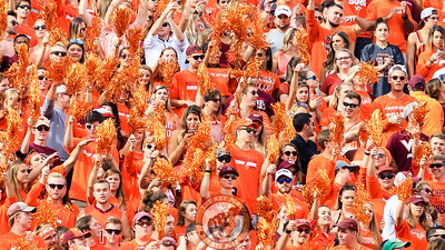 Fans in the North endzone stands wave pompoms before Enter Sandman begins. (Mark Umansky/TheKeyPlay.com)