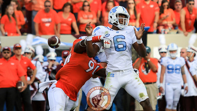 Trevon Hill strips the football out of UNC QB Brandon Harris' hand. (Mark Umansky/TheKeyPlay.com)