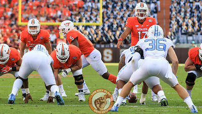 Virginia Tech QB Josh Jackson (17) adjusts a play call at the line deep in the UNC red zone. (Mark Umansky/TheKeyPlay.com)
