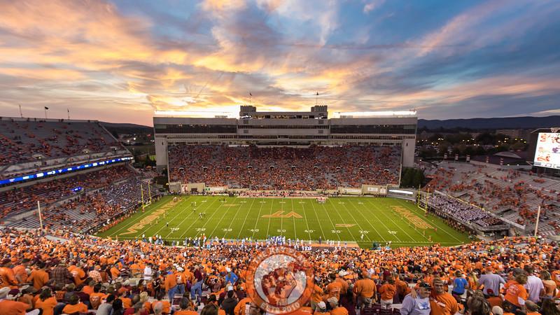 The sun sets on Blacksburg and Lane Stadium in the 4th quarter. (Mark Umansky/TheKeyPlay.com)