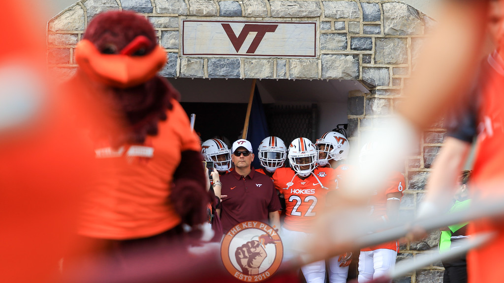 Head coach Justin Fuente stands at the entrance of the tunnel as Enter Sandman plays inside Lane Stadium. (Mark Umansky/TheKeyPlay.com)