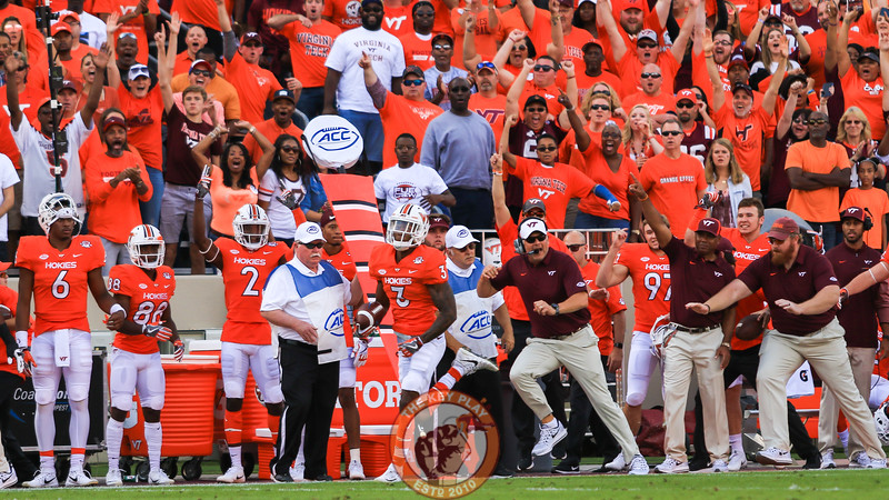 Greg Stroman (3) runs with the football on route to score a 91 yard punt return for a touchdown as head coach Justin Fuente runs along the sideline right beside him. (Mark Umansky/TheKeyPlay.com)