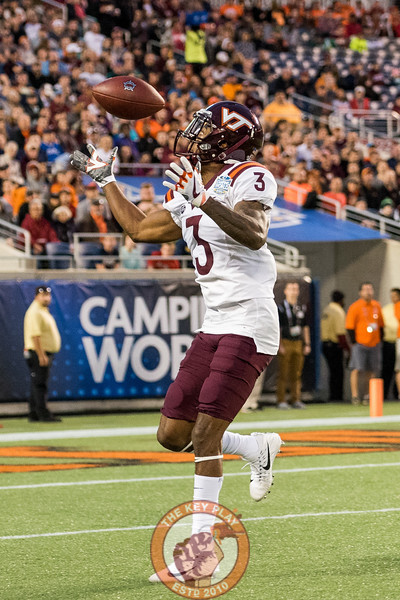 Greg Stroman tries to wrangle in a bouncing punt in the Camping World Bowl between Virginia Tech and Oklahoma State in Orlando, Fl., Thursday, Dec. 28, 2017. (Special by Cory Hancock)