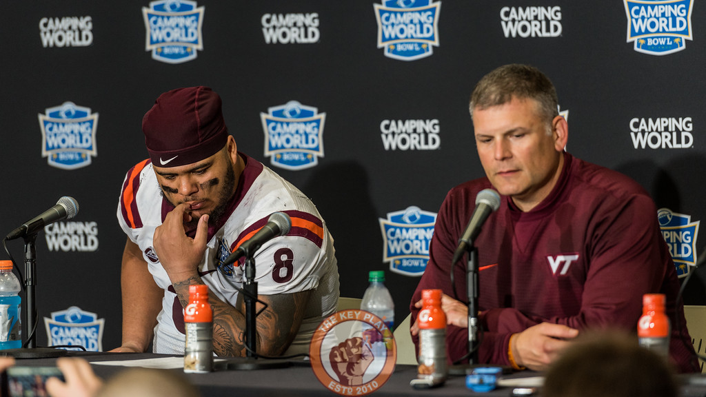 Ricky Walker (8) and Justin Fuente give a post-game press conference after losing the Camping World Bowl to Oklahoma State 21-30 in Orlando, Fl., Thursday, Dec. 28, 2017. (Special by Cory Hancock)