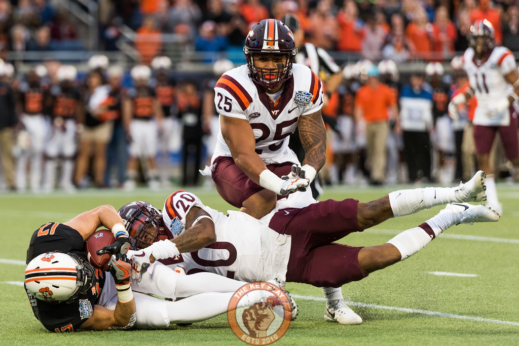 Deon Newsome (20) tackles Dillon Stoner (17) in the Camping World Bowl between Virginia Tech and Oklahoma State in Orlando, Fl., Thursday, Dec. 28, 2017. (Special by Cory Hancock)