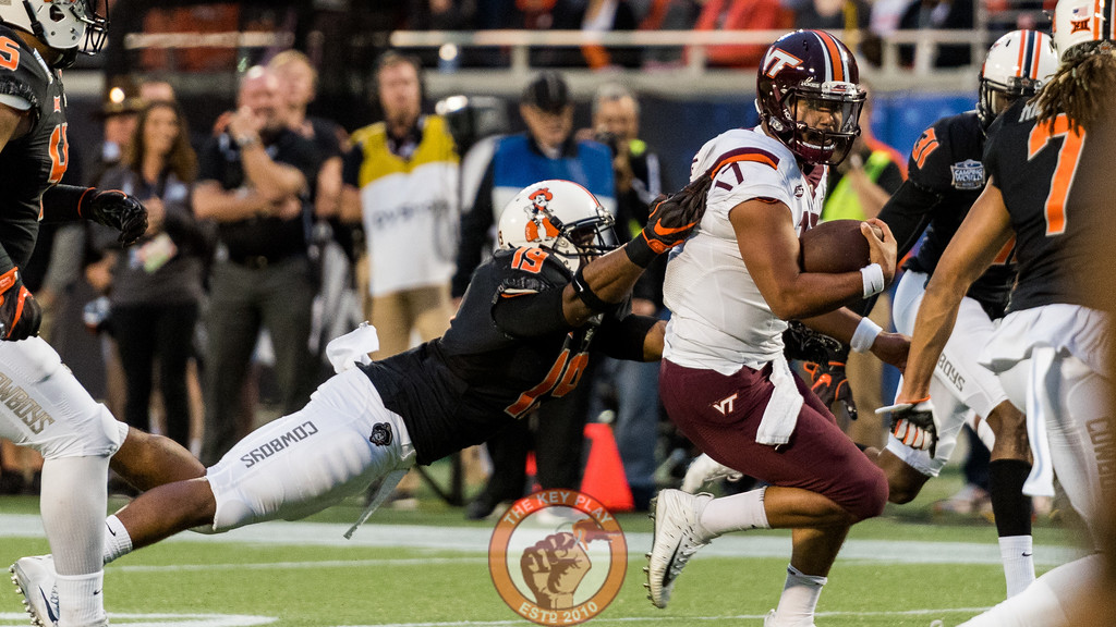 Quarterback Josh Jackson (17) slips a tackle en route to the end zone during the Camping World Bowl between Virginia Tech and Oklahoma State in Orlando, Fl., Thursday, Dec. 28, 2017. (Special by Cory Hancock)