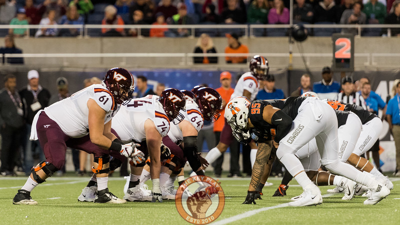The Virginia Tech offensive line squares off with the Oklahoma St. defensive line during the Camping World Bowl between Virginia Tech and Oklahoma State in Orlando, Fl., Thursday, Dec. 28, 2017. (Special by Cory Hancock)