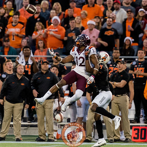 Wider receiver Henri Murphy (12) jumps while being held to catch a deep pass from Josh Jackson in the Camping World Bowl between Virginia Tech and Oklahoma State in Orlando, Fl., Thursday, Dec. 28, 2017. (Special by Cory Hancock)
