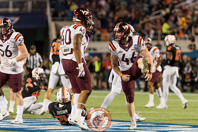 Kicker Joey Slye (46) celebrates a solo tackle on a kickoff in the Camping World Bowl between Virginia Tech and Oklahoma State in Orlando, Fl., Thursday, Dec. 28, 2017. (Special by Cory Hancock)