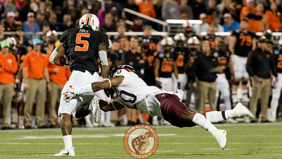 Deon Newsome (20) dives in an attempt to tackle Justice Hill (5) in the Camping World Bowl between Virginia Tech and Oklahoma State in Orlando, Fl., Thursday, Dec. 28, 2017. (Special by Cory Hancock)