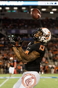 Tyron Johnson tries to wrangle in a bouncing punt in the Camping World Bowl between Virginia Tech and Oklahoma State in Orlando, Fl., Thursday, Dec. 28, 2017. (Special by Cory Hancock)