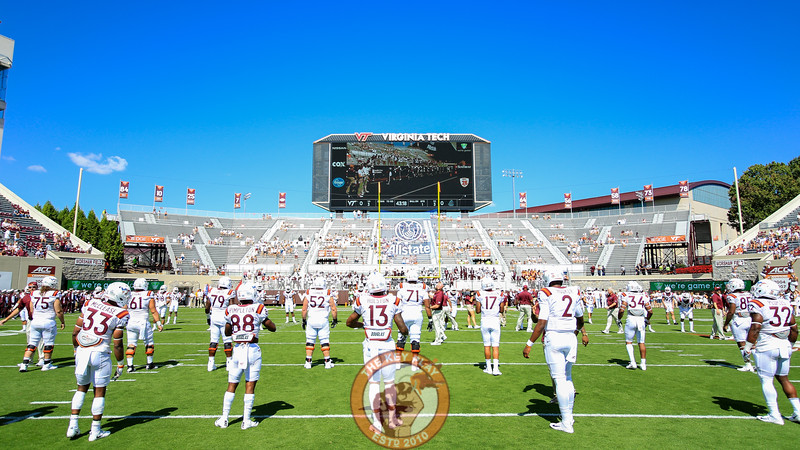 The Hokies warm up as the stands start to fill up for Military Appreciation Day. (Mark Umansky/TheKeyPlay.com)