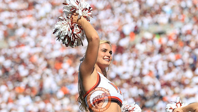 A Virginia Tech cheerleader entertains the crowd during a media timeout. (Mark Umansky/TheKeyPlay.com)