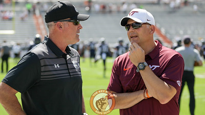 Virginia Tech head coach Justin Fuente (right) talks with ODU head coach Bobby Wilder (left) as the two teams warm up before the game. (Mark Umansky/TheKeyPlay.com)