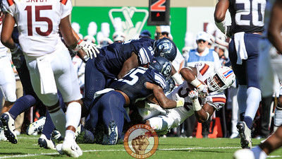 RB Steven Peoples gets dragged down by several ODU defensive players. (Mark Umansky/TheKeyPlay.com)