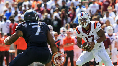 QB Josh Jackson looks to avoid ODU's Oshane Ximines. (Mark Umansky/TheKeyPlay.com)