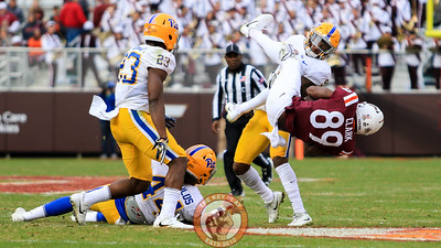 WR James Clark is upended after a catch in the fourth quarter. (Mark Umansky/TheKeyPlay.com)