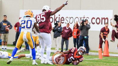 WR Cam Phillips (5) falls into the endzone to put Virginia Tech up 20-14 in the fourth quarter. (Mark Umansky/TheKeyPlay.com)