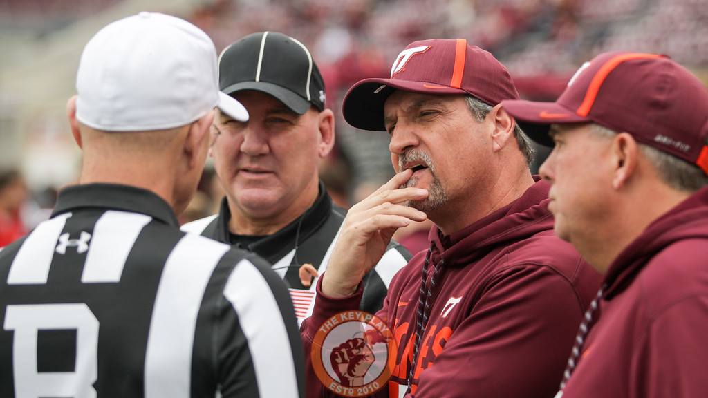 Bud Foster has a pregame discussion with the referees. (Mark Umansky/TheKeyPlay.com)
