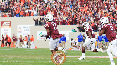Houshun Gaines (11) runs towards the Virginia Tech sideline after the Hokies stopped Pittsburgh on a goal line stand to win the game. (Mark Umansky/TheKeyPlay.com)