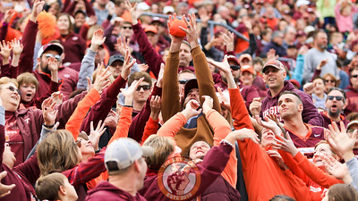 Fans reach up to try and catch a free t-shirt during a promotion on the field. (Mark Umansky/TheKeyPlay.com)