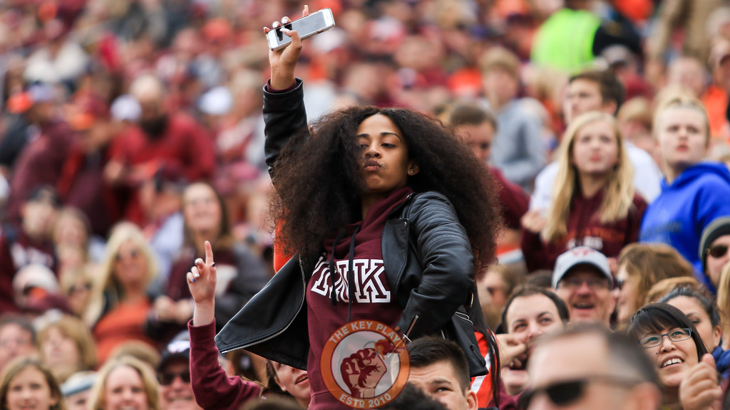 A fan dances to music on Hokievision during a media timeout. (Mark Umansky/TheKeyPlay.com)