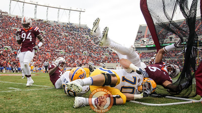 Mook Reynolds (6) falls into a kicking net on the sidelines after chasing a play out of bounds. (Mark Umansky/TheKeyPlay.com)