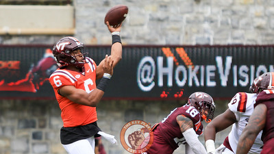 QB A.J. Bush, fires off a pass during his first action in the game. http://www.hokiesports.com/football/players/images/teller_wyatt.png